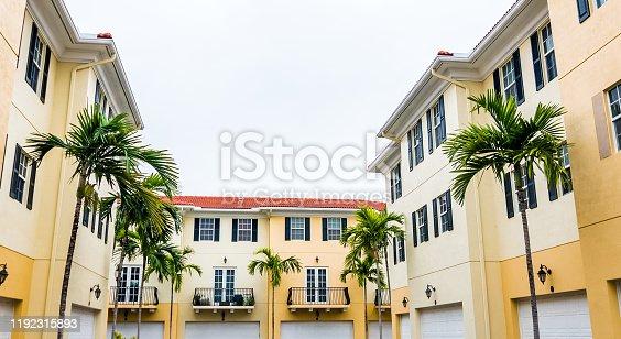 108220043 istock photo Residential townhouses in suburban community neighborhood 1192315893