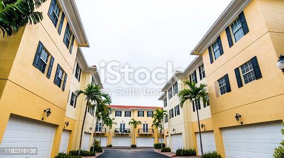 108220043 istock photo Residential townhouses in suburban community neighborhood 1192316138