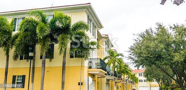 108220043 istock photo Residential townhouses in suburban community neighborhood 1192316141