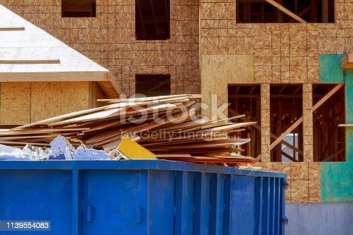 istock Residential view of new houses being built and construction garbage 1139554083