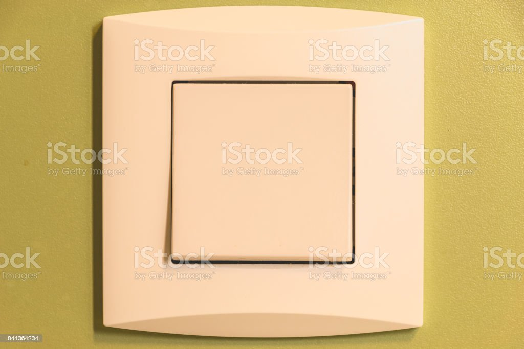 residential wall switch on a green wall stock photo