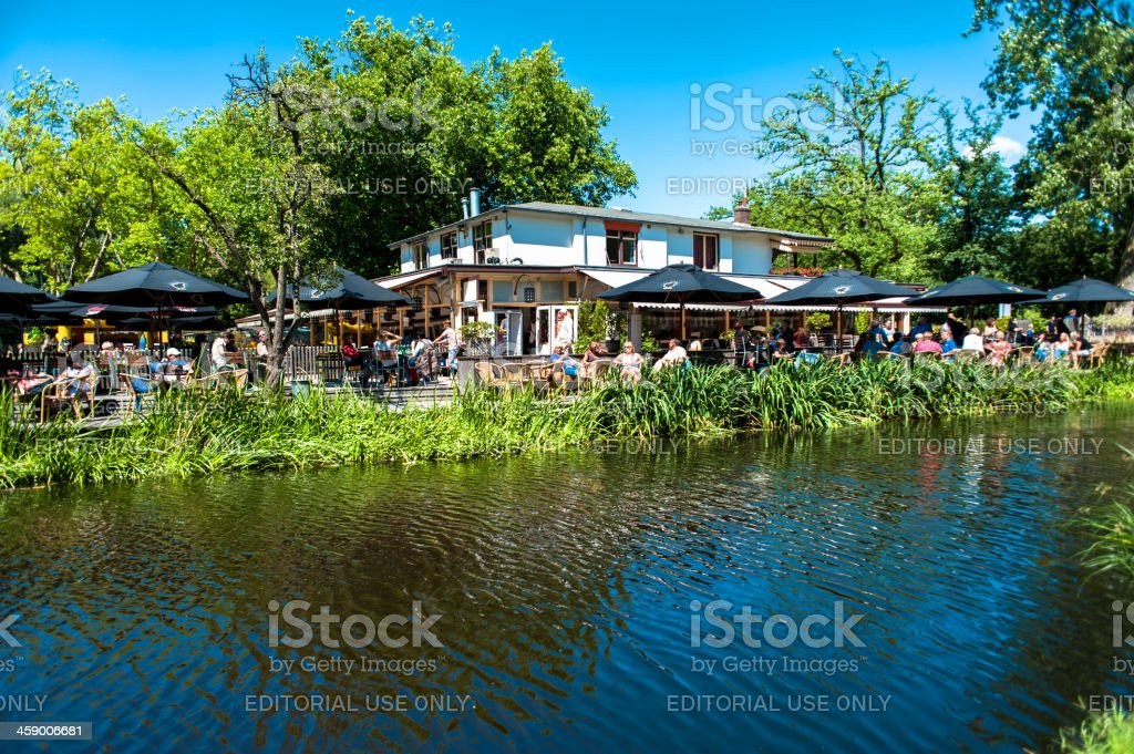 Residents and Tourists relax at the Groot Melkhuis in Amsterdam stock photo