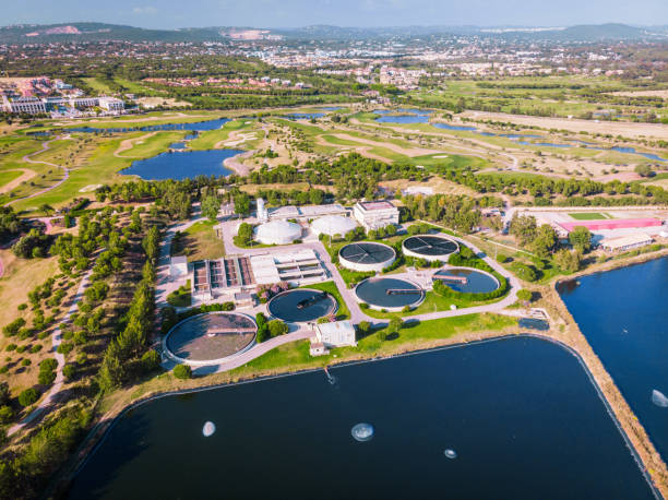 Residual water station near a golf course in Vilamoura, Algarve, Portugal. Aerial view of Vilamoura and its golf course in Algarve, Portugal. sewage treatment plant stock pictures, royalty-free photos & images