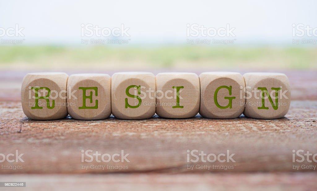 Resign word written on cube shape wooden blocks on wooden table. stock photo