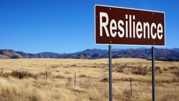 resilience road sign with blue sky - endurance stock pictures, royalty-free photos & images