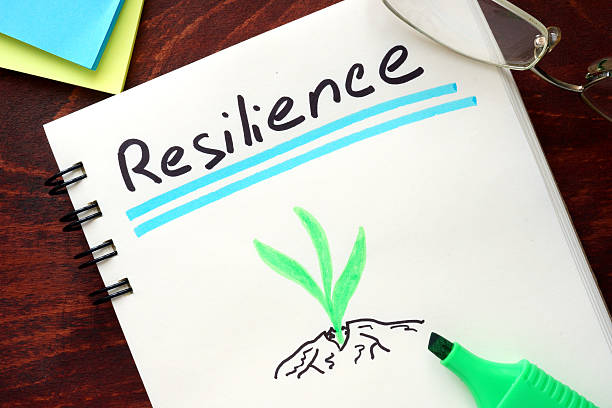 resilience written on notepad on a table. - resilience concept stock photos and pictures