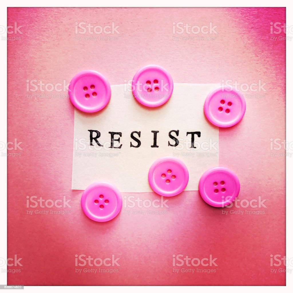 Resist on Pink with Buttons Concept stock photo