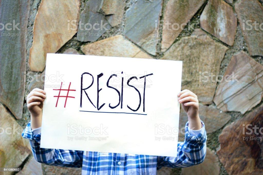 Resist Boy holding resist sign Activist Stock Photo