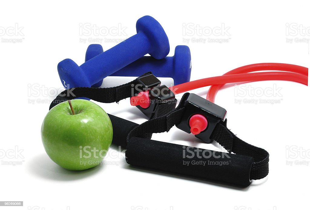 Resistance Band, Blue Weights and Green Apple royalty-free stock photo