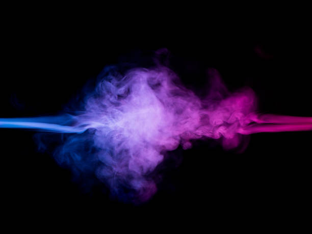 resistance of blue and red smoke in motion stock photo