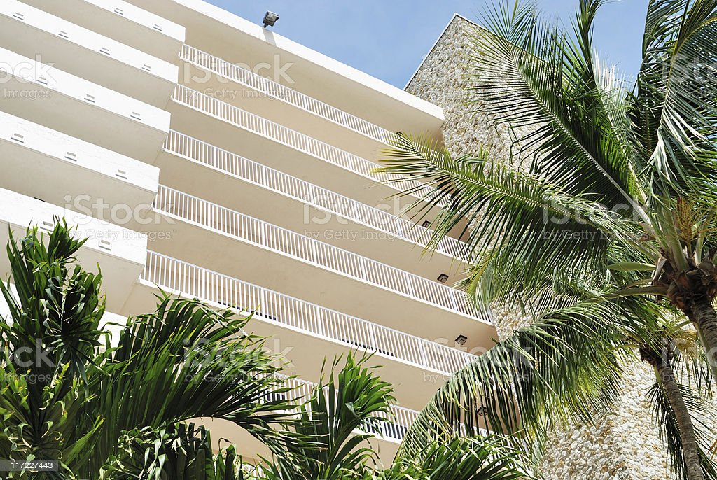 Resort apartments with palms stock photo