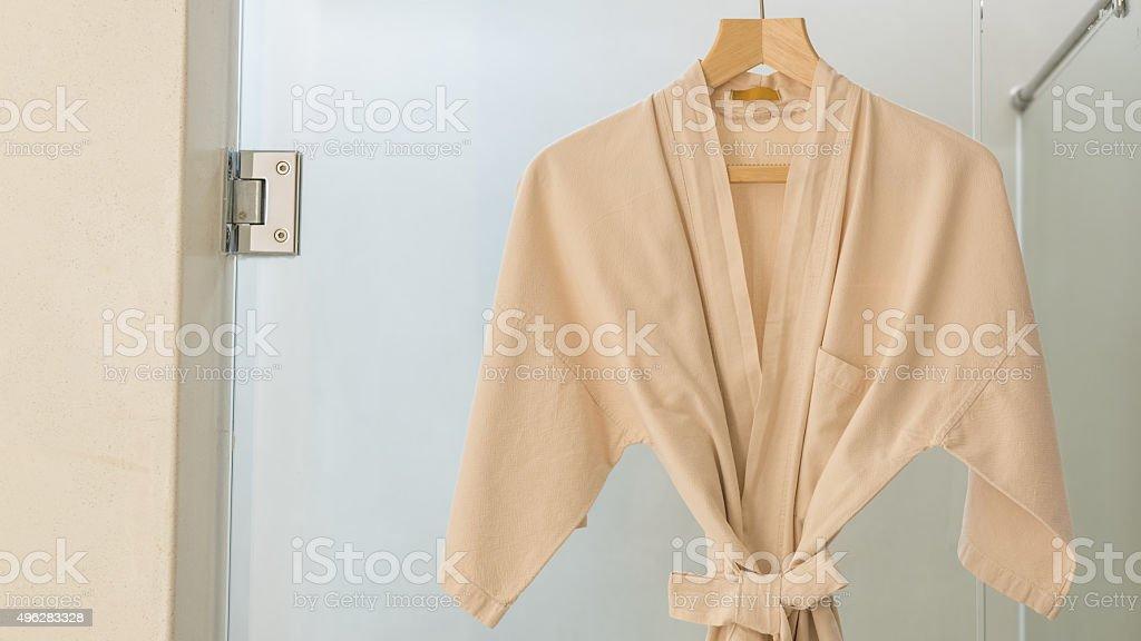 Resort Bath Robe Hanging on the Shower Room stock photo