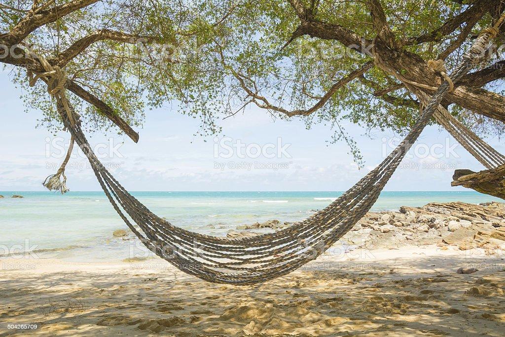 Resort hotel beach side Pacific ocean front hammock stock photo