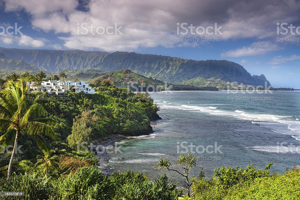 Resort overlooking Hanalei bay and Emerald Mountains of Kauai, Hawaii. stock photo