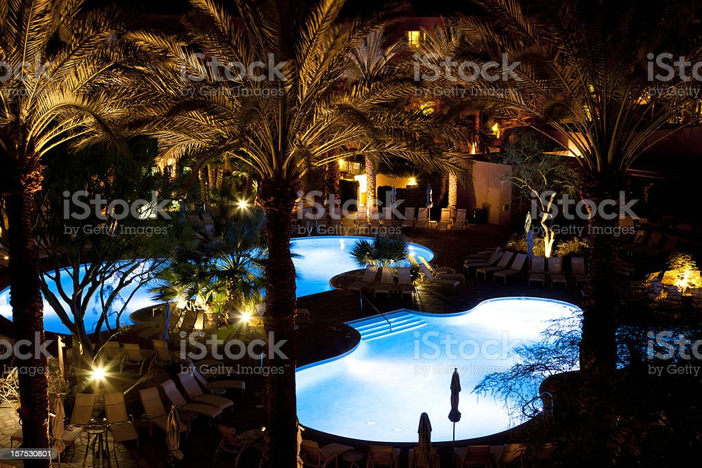 Resort Pools At Night With Palm Trees royalty-free stock photo