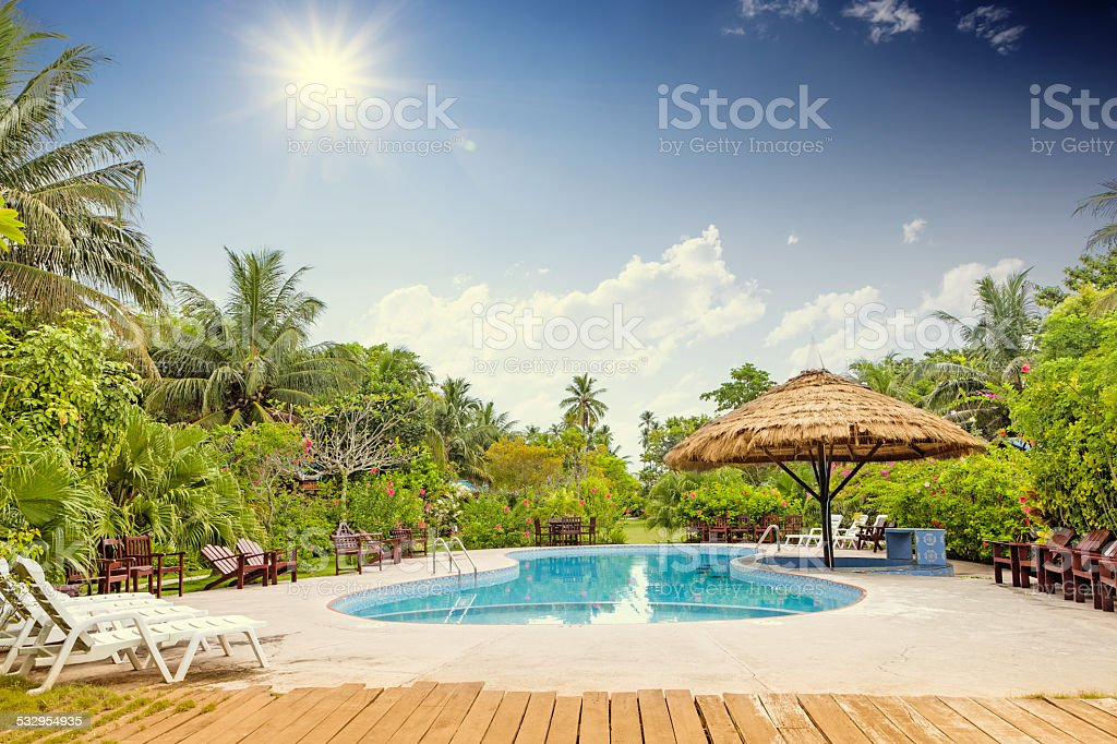 Resort swimming pool with empty plank board stock photo