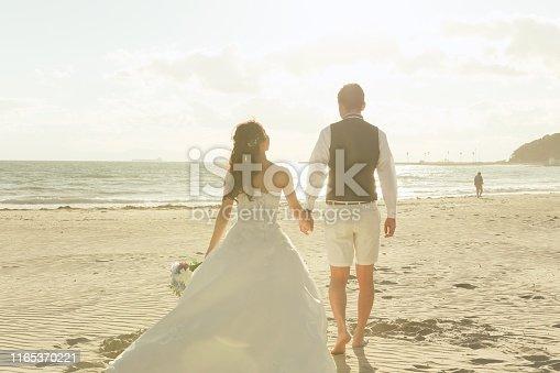 Asian couple is thinking their honeymoon