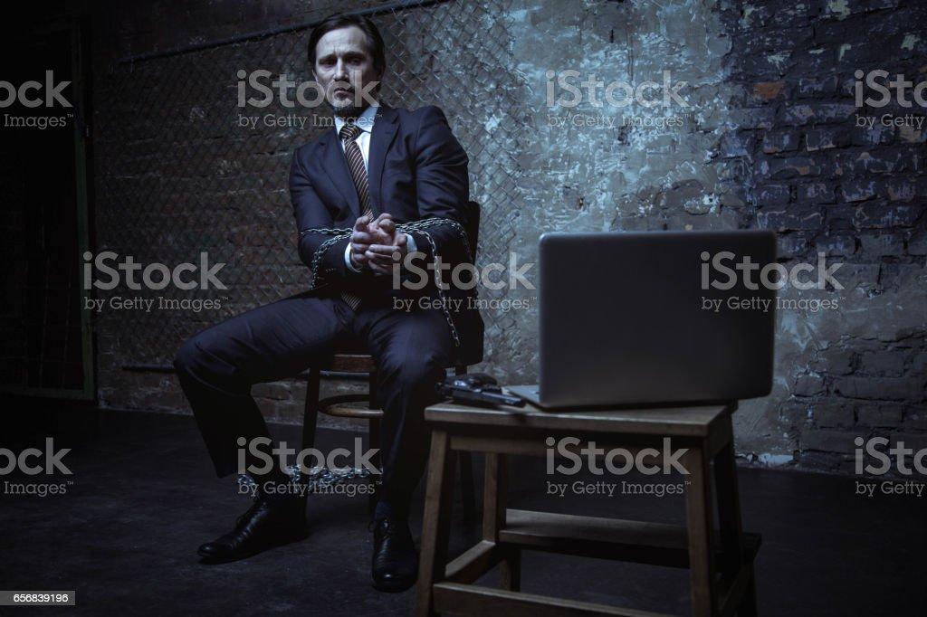 Resourceful kidnapped man pointing at gun stock photo