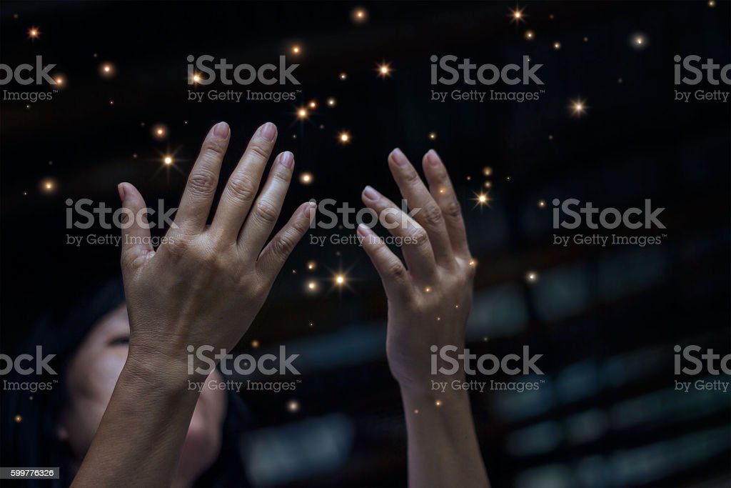 Respect and pray and stardust on city at night background stock photo