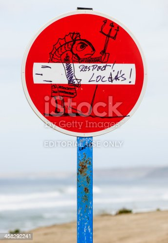 Lourinha, Portugal - October 22, 2012: No Entry traffic Sign at Peralta Beach with by hand drawn art claiming respect for local surfers.