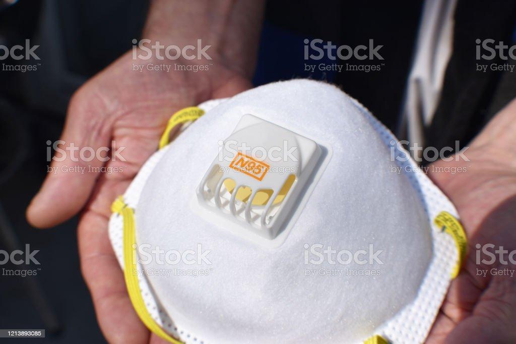 N95 Respirator In Elders Hands Close Up High Quality N95 Respirator In Elders Hands Close Up Apocalypse Stock Photo