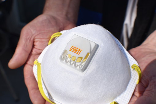 N95 Respirator In Elders Hands Close Up High Quality Stock Photo - Download Image Now