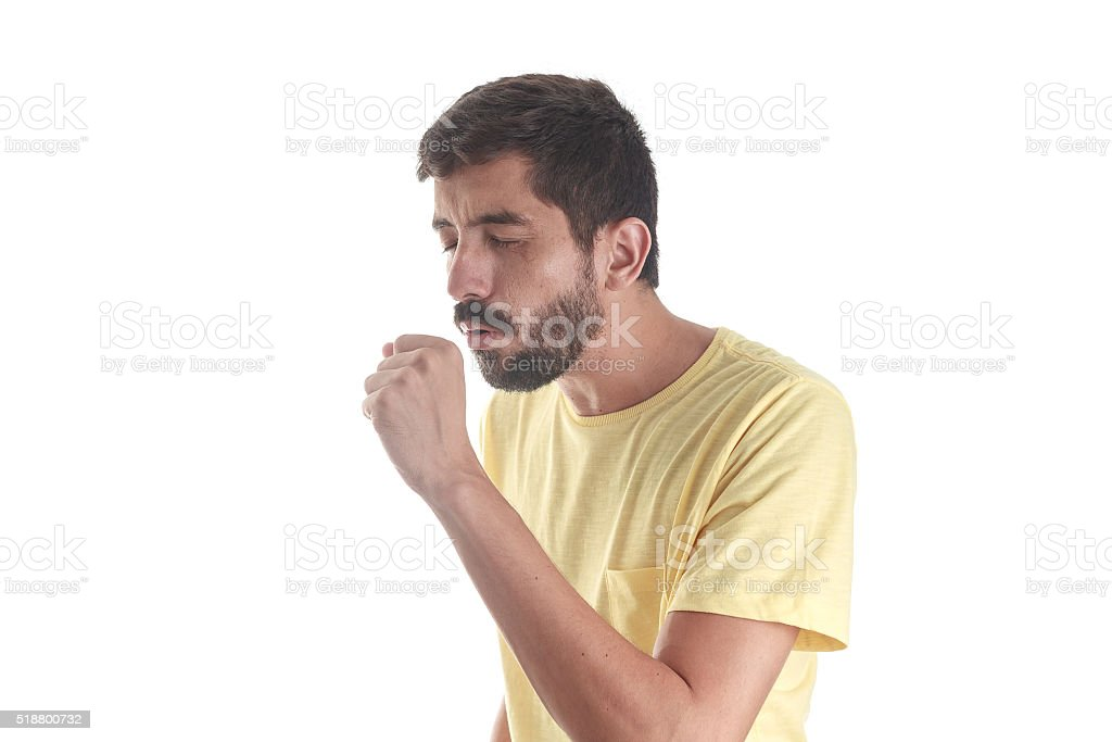 Respiratory disease. Young man coughing on white background stock photo