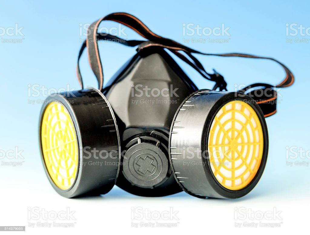 respiratory protection mask on blue stock photo