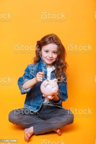 Responsible girl putting money into piggy bank for future saving picture id1148273396?b=1&k=6&m=1148273396&s=612x612&h=p56rlutrgstz1km0ubc4b2wybsk3gnm8fzkxrnowck4=