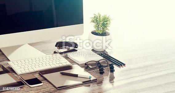 Designer's desk with responsive design mockup concept.
