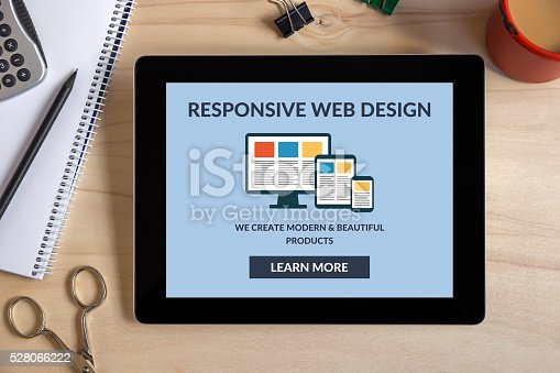 istock Responsive web design concept on tablet screen with office objects 528066222