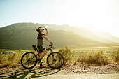 Shot of a mature man having a water break while out for a ride on his mountain bike