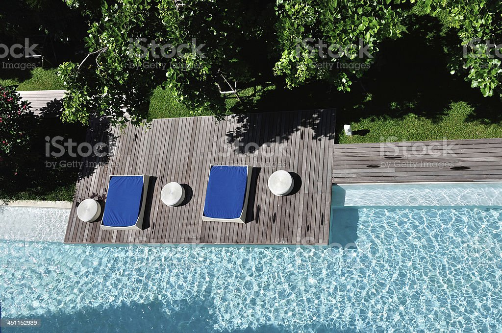 Rest area beside swimming pool at the resort. stock photo