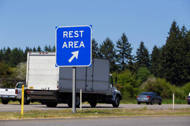 Rest Area Highway Sign and Vehicles stock photo