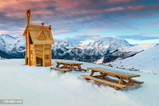 Spectacular resting place with wooden house and tables in the high mountains at sunrise, Alpe d'Huez, France, Europe