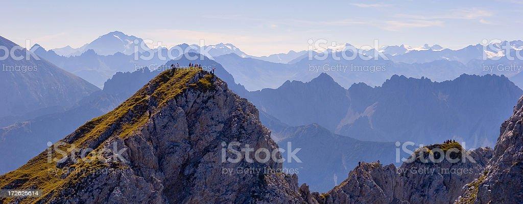 Rest on mountain peak stock photo