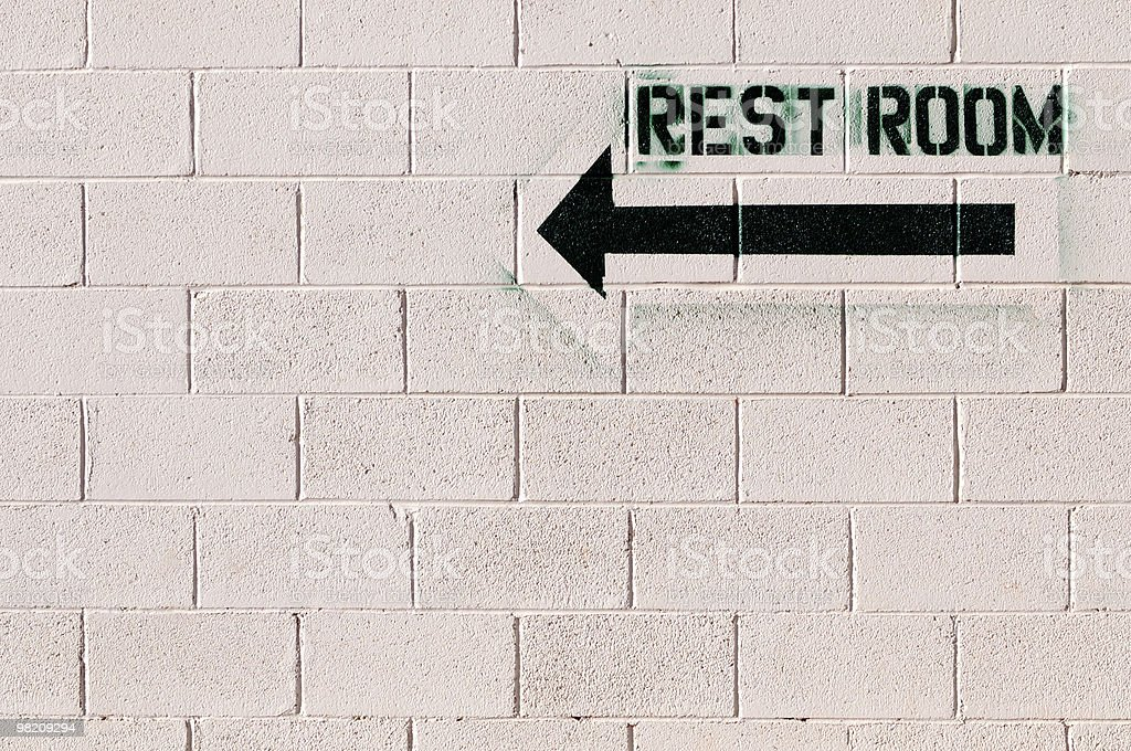 Rest Room Black Spray Paint Stencil on White Brick Wall royalty-free stock photo