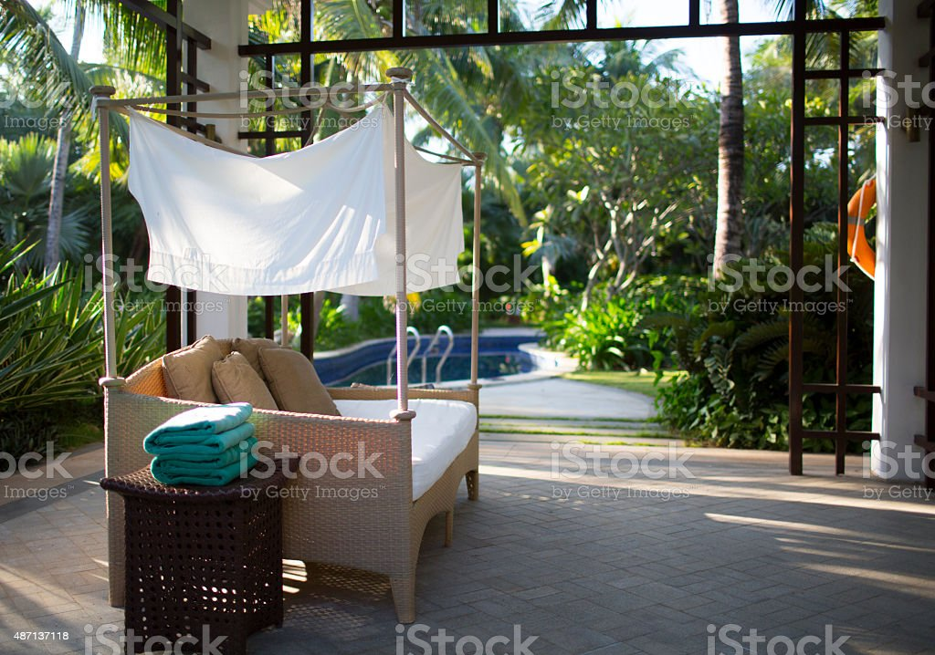 rest sofa near the swimming pool stock photo