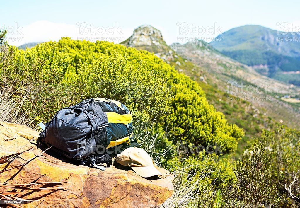 Rest stop on mountain hike wth backpack and cap stock photo