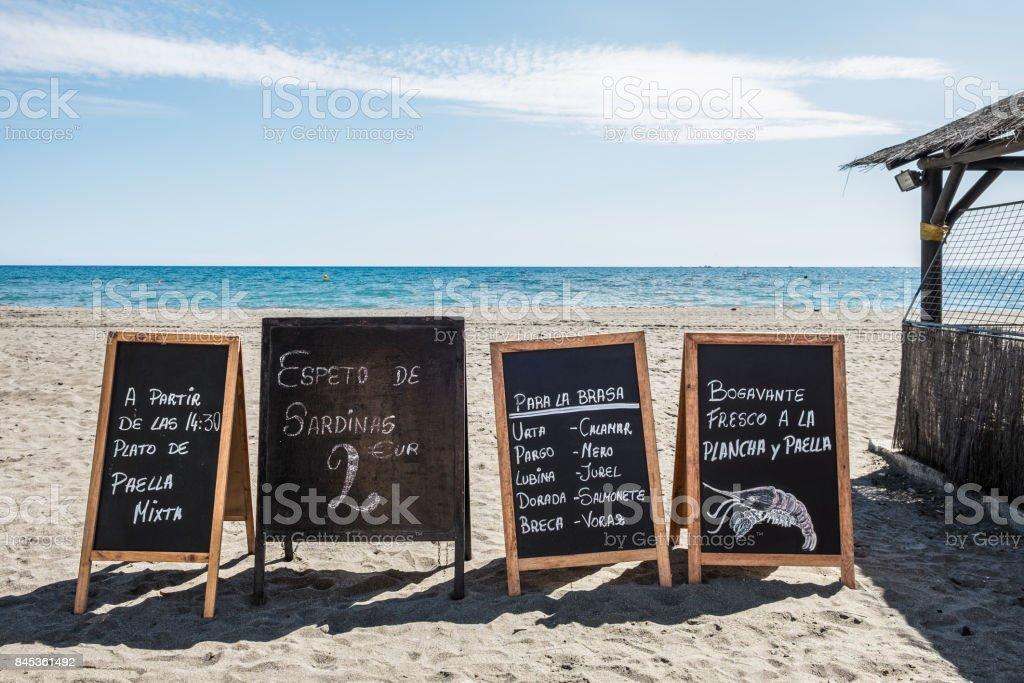 Restaurant ads on the beach. stock photo