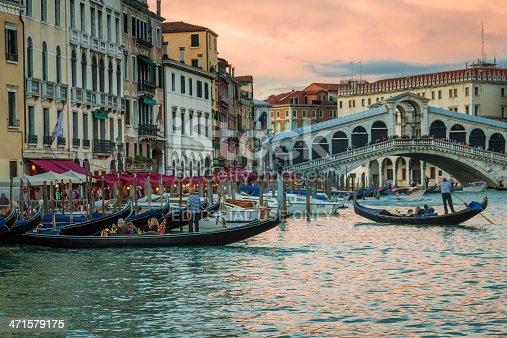 istock Restaurant and gondolas near the Rialto Bridge in Venice 471579175