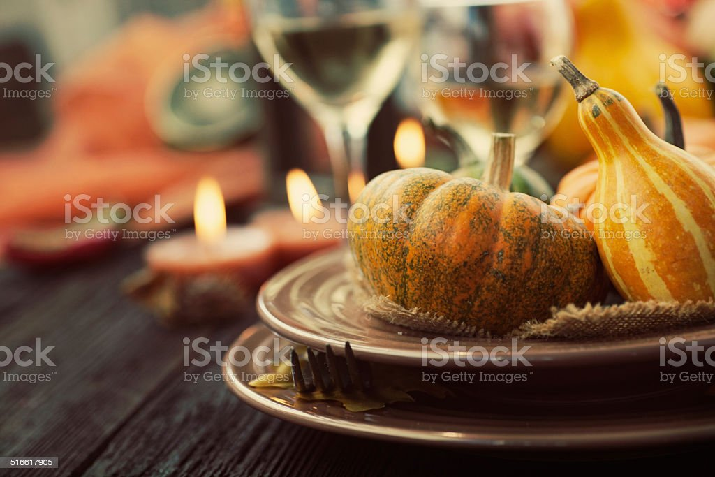Restaurant autumn place setting Autumn table setting with pumpkins.  Thanksgiving dinner and autumn decoration. Arranging Stock Photo