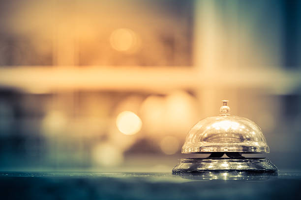 Restaurant bell Restaurant bell vintage with bokehRestaurant bell with bokehRestaurant bell vintage with bokeh concierge stock pictures, royalty-free photos & images