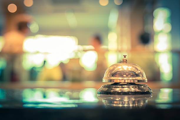 Restaurant bell service Restaurant bell service vintage with bokehRestaurant bell service vintage with bokeh concierge stock pictures, royalty-free photos & images