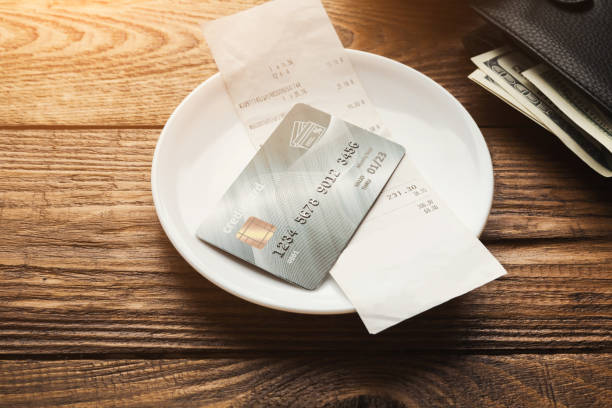 restaurant bill and credit card on wooden table - receipt stock photos and pictures