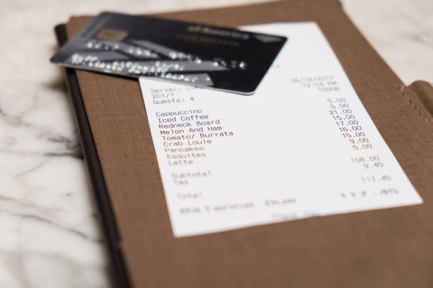 restaurant bill with credit card - receipt stock photos and pictures