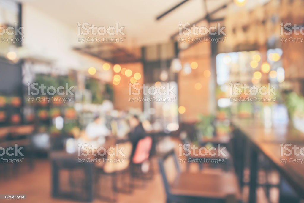 Restaurant cafe or coffee shop interior with customer blur abstract...
