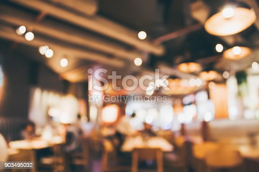istock Restaurant cafe or coffee shop interior with people abstract blur background 903495032