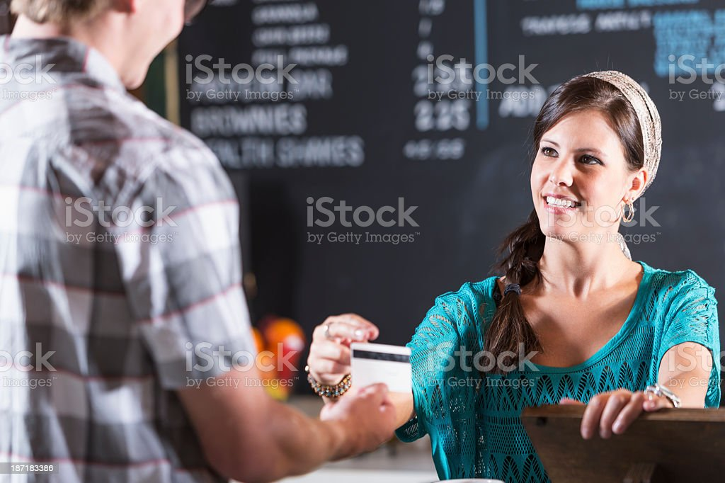 Restaurant cashier reaches for customer card royalty-free stock photo