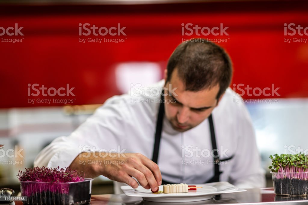 Restaurant Chef Putting Decorations On A Small Bitesized Molecular Gastronomy Meal Prepared To Look Like Ice Cream Stock Photo Download Image Now Istock
